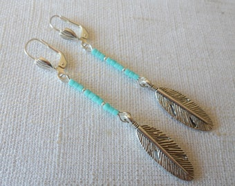 Earrings with turquoise beads and silver feather