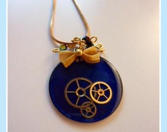 Blue polymer and clockwork resin necklace