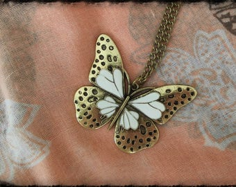 Necklace in bronze with a beautiful colorful Butterfly in white
