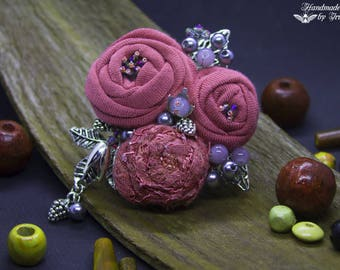 Old textile brooch, pink and gray