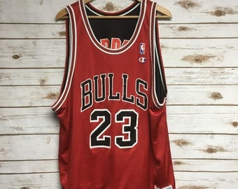 67e7902b2 ... Vintage 90s Michael Jordan Chicago Bulls reversible distressed jersey  black and red number 23 Jordan Champion Vintage Champion Original ...