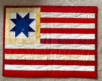 Red, white and blue for The Fourth of July.  These placemat sized little quilts would be great on the wall or table.