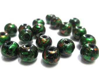 20 beads black speckled orange and green shiny glass 6mm