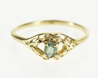 14k Oval Cut Blue Topaz Scalloped Trim Solitaire Ring Gold