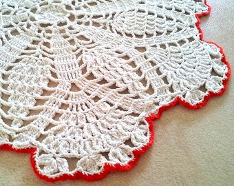 Doily. Vintage crochet. Big and round. White and red.