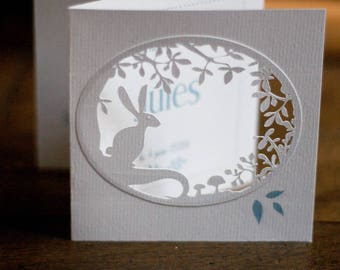 A paper cutted birth announcement
