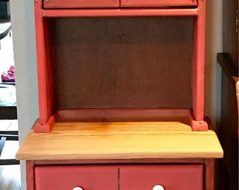 Rustic refinished red milk paint jelly cabinet with a handpainted BEE