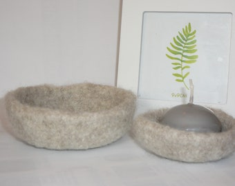 pair of beige felted baskets