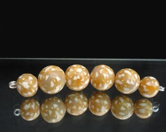 six sand coloured polymer clay beads