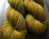 Brass Monkey- Hand Dyed Superwash Merino Nomad Sock Fingering Yarn
