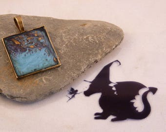 A water effect abstract art pendant