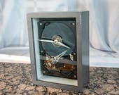 Silver handmade frame Clock made from a computer hard drive.  For Techie/Nerd/Geek or Creative person. A Creative clock for a man or woman.