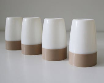 4 Tupperware egg cups with covers