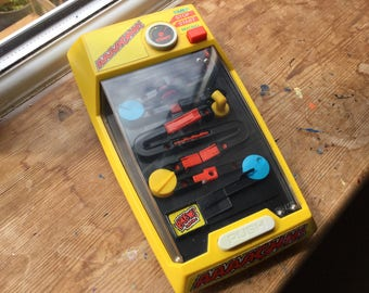 Vintage AAAAGHH game by Tomy in good working order from the 1980's