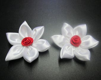 Red and white satin with a flower is adorned with a small pink