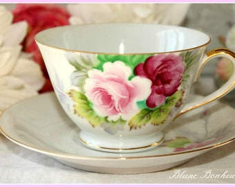 Gold Occupied Japan: Tea cup and saucer with hand painted large roses
