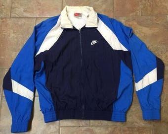 1990's Nike blue windbreaker jacket track
