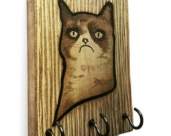 What's not to love about this guy? Hand Painted Rustic Hanger. A fun and functional gift for grumpy cat lovers!