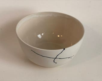 ceramic bowls with black linear detail