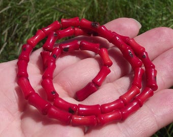 4 RED CORAL BEADS. 10X5MM.