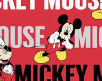 """Mickey Mouse words on red by Springs Creative fabric, By the Half Yard, 42"""" wide, 100% cotton"""
