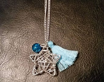 Necklace with charm, bead and tassel