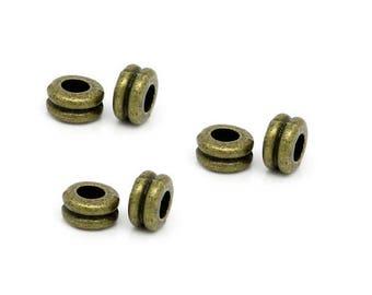 Set of 10 beads bronze metal double 6 mm x 3 mm
