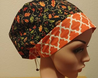 Women's Surgical Cap, Scrub Hat, Chemo Cap, Fall Leaves with Orange Quartefoil Band