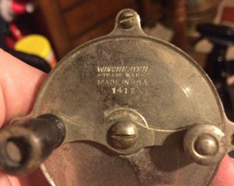 Antique winchester fishing reel