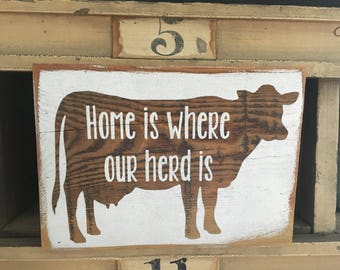 "Cow/heifer silhouette  ""Home is where our herd is""."
