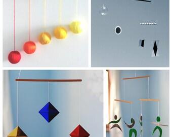 Set of 4 Montessori Mobiles. Munari. Orange Gobbi. The Dancer Mobile. The octahedron Mobile. Hanging mobile. Classic Montessori mobiles.