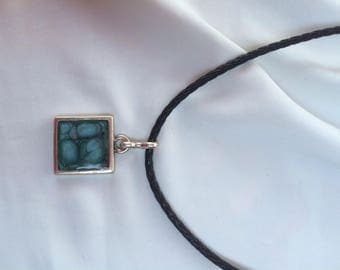Silver metal pendant and cord. Black Choker