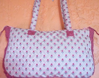 Pouch bag in floral satin