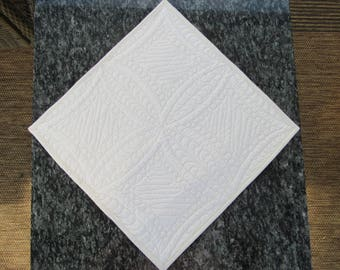 Ecru quilted table runner. 14 x 14 inches