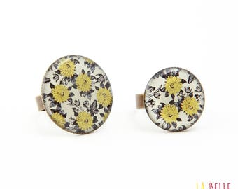 resin black and mustard yellow floral pattern ring