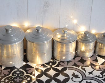 Set of 5 nesting canisters made of aluminum, 20 years. France.