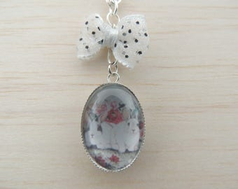Rabbits and white bow cabochon necklace