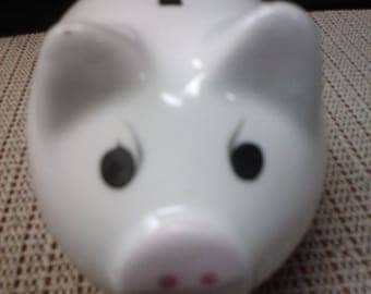Pink flowered angry pig bank.