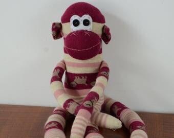 Maroon stripped monkey, sock monkey, maroon monkey
