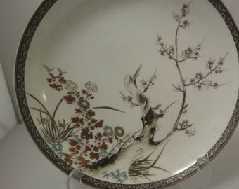 Chinese plate depicting bird in tree and leaves    dia 25cm