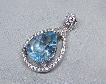Blue Topaz silver pendant and Zirconium