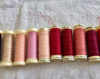 Vintage Gutermann threads. Red and pink hues. 10 in total.
