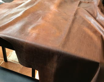 Espresso Distressed Cowhide (limited offer) 1 showroom skin 15 sq feet with a light mark down the middle. Beautiful, soft handfeel