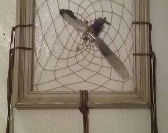 Lovingly crafted dream catcher.