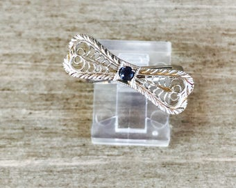 14k filigree bow ring with synthetic blue sapphire