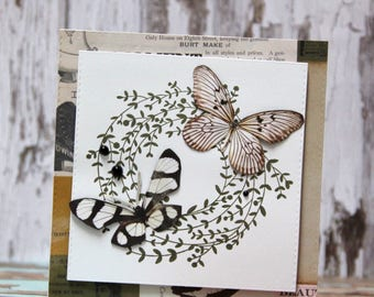 Card with brown wreath and two butterflies