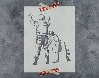 Girl with Soldier Banksy Stencil - Reusable DIY Craft Stencils of a Girl Patting Down a Soldier by Banksy
