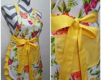 Youth apron. Girl's apron. Bright colorful floral on main with yellow pocket, ties and frills.