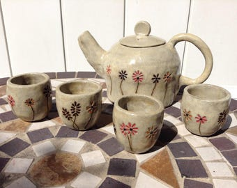 One of a kind Fine Art Ceramic teapot with flowers and w/4 matching numbered teacups, signed and dated by the artist