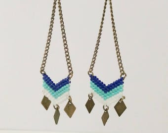 Earrings chevron weaving pearls dark blue cobalt, turquoise and white with bright reflections.